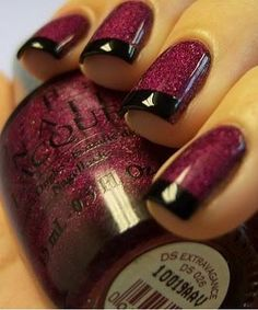Chic wine colored nails with black tips.