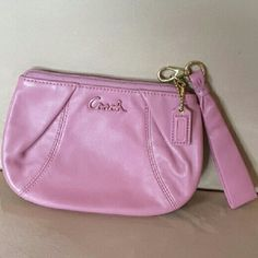 "*****Price Firm***** Coach Wristlet 5  1/4"" height, 7 1/4"" width, NWOT, light purple/ lavender, gold hardware, zippered top with detachable handle. Inside main compartment  has 1open pocket. Interior lined in lighter purple fabric.  Perfect condition inside &out. Never used. Coach Bags Clutches & Wristlets"