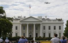 The space shuttle Discovery, riding atop a NASA 747 transport jet, does a final fly-by over the White House as tourists an Washingtonians watch and take pictures in Washington, April 17. Discovery will go on display at the National Air and Space Museum's Udvar-Hazy Center.