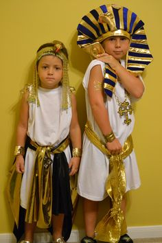 Pharoah costumes for Egyptian week at school. I started with small adult white t-shirts and gold lamey fabric for the belts and girl cape. The head pieces are from the party store.