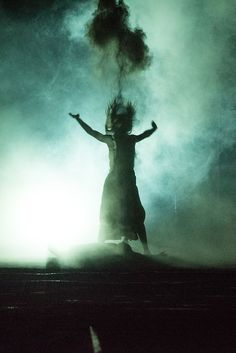Antigone is burying her brother Polynices by throwing ashes in the air, Burgtheater 2015.