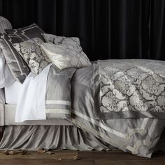The Lili Alessandra Versailles duvet cover proves essential for elegant bedrooms in opulent tones. This bedspread features a background in sleek silver, trimmed with three rows in white velvet and adorned with a medallion-style design at the corners. Queen: 96in W x 98in L. King: 112in W x 98in L. Velvet. Silver, ivory. Machine wash gentle cycle, gentle detergent, dry on low until almost dry, lay flat to finish drying.
