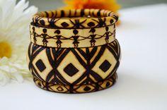 Wood burned amazing geometrical shapes and warli art design wooden bangles. Set of 4 for 60$. #wooden Bangle,#tribal bangle,#warli art