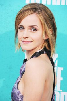 In 2012, Emma Watson arrives on the MTV Movie Awards red carpet with her natural beauty aglow.