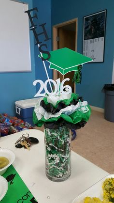 Graduation Centerpiece for Farmington High School.. Farmington, NM Home of the Scorpions, Colors are green, black & white.. Class of 2016
