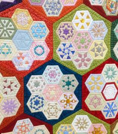 close up, 'Raconteur the Storyteller's Collection' by Cinzia White, Australia. Hexagon designs within hexagons. 2014 Festival of Quilts, photo by Fabadashery