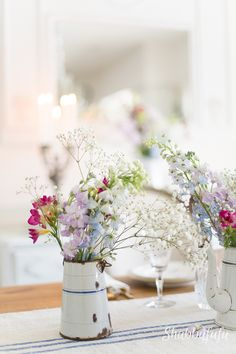 How To Add French Farmhouse To Your Mantel and your home For Spring. Use old books, baskets, zinc pitchers and pots and dried flowers to create the look of an old farmhouse in France.