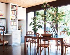 Love the contrast of materials, light and dark, built-in desk, cork floors