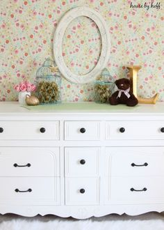 The cutest little girl's room with an awesome accent wall-- it's removable wallpaper! | HouseByHoff.com