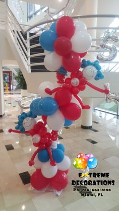 Dr Seuss Thing 1 and Thing 2 Balloon Column. Party decorations Miami. Cat in the hat party decoration ideas. Balloon Decorations. Extreme Decorations Ph: 786-663-8198 www.extremedecorations.com