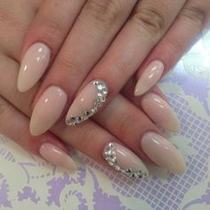 nude nails with a touch of bling