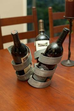 Beautiful wine holder made from the steel bands on wine barrels... I'm totally riffing on this next time I have extra strap...