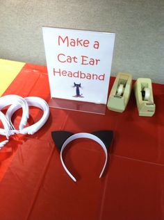 Make a cat ear headband by cutting cat ears out of black construction paper and hot gluing (or taping) to a headband.