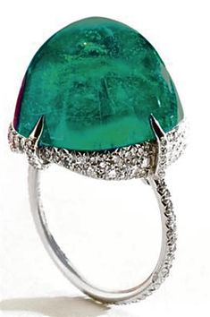 Cartier ring featuring a very large columbian emerald and pave-set diamonds, platinum.  c. 1920