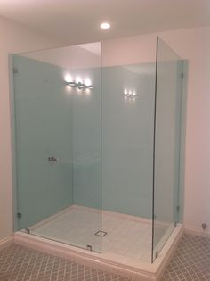 Shower with light blue back painted glass