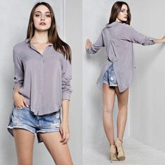 """""""Enchanted Grey Lux Blouse"""" Simple silky top with a unique inverted button detail in the front. Perfectly executed with a jaw dropping button slit back. You will love how it feels against your skin! Super smooth and comfortable!  • 100% Rayon • Available in Mocha, Navy, Grey. WILDDREAMS Tops Blouses"""