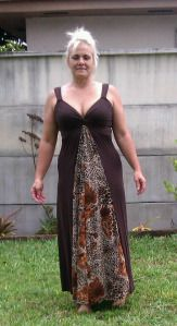 Well just last year I fit in it and this year… And the Animal print well kinda looked like an old ladies moo-moo dress. So I cut the printer one up the sides. I used the back because it was t…