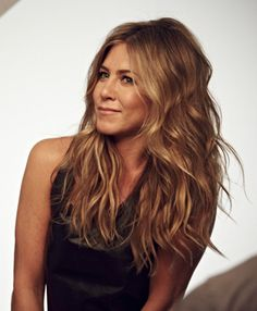 After blow drying hair, use a large barrel curling iron to curl the length of the hair. Finish by spraying hair with sea salt to add texture.