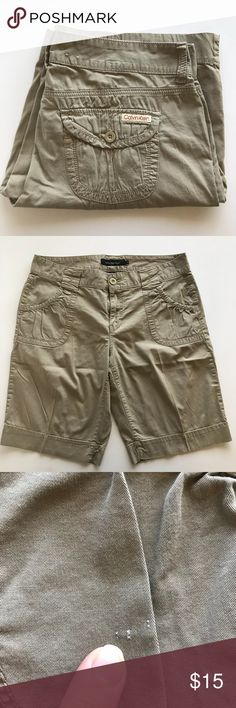 "NWOT Calvin Klein Shorts Tan (Rack) Super cute CK shorts! Size 14. Mostly cotton NWOT! Tan color, cute bunched rounded pockets. One small pin sized blemish (see photos). 18"" waist, 21"" length, 11"" leg width, 11"" inseam. Calvin Klein Shorts"