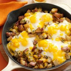 Baked eggs and potatoes with cheddar