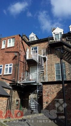 Steel Fabricators of Balconies, Staircases. steel spiral fire escape, installed and manufacture by Bradfabs for commercial property in North East, fabricated and delivered throughtout the UK Spiral Staircase Plan, New Staircase, Staircase Railings, Staircase Design, Spiral Staircases, Staircase Architecture, Architecture Design, Chambord Castle, Basement Staircase