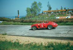 "Juan Manuel Fangio in his Ferrari 860 Monza entering the ""Nordkurve"" at the 1000 Km Race 1956 (qualifying: 10:03.6)"