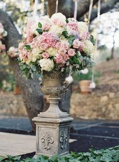 Pale Pink %26 Ivory Hydrangea Arrangement    Photography: Caroline Tran   Read More:  http://www.insideweddings.com/weddings/magical-garden-ceremony-tented-reception-with-chic-french-theme/733/