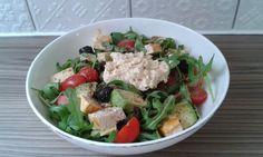 Rocket, tomato avocado and olive salad with marinated tofu and humous