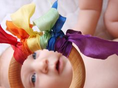 "Cute idea for a baby ""tickler"" - a good sensory tool you can make yourself with some ribbon and a ring from a craft store!"