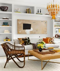 As this renovation by designer Ariel Okin shows, punchy accessories can liven up even the most neutral territory. #colorfulinteriors #lightfilledinteriors #stylishdens #centralparkapartments #elledecor Beautiful Interior Design, Beautiful Interiors, Mismatched Dining Chairs, Rattan Armchair, Living Styles, Elle Decor, Soft Furnishings, White Walls, Interior And Exterior