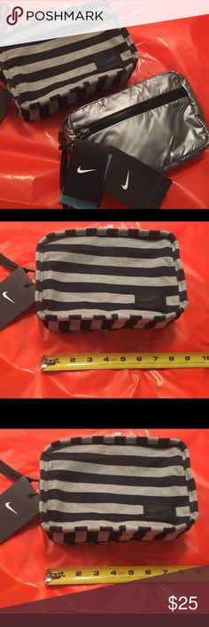 """One Nike Silver Reversible Clutch/Wristlet NWT  One Nike Silver Reversible Clutch/Wristlet New With Tags.This is reversible. It's silver on one side & navy bluish color with gray stripes on the reversible side.YOU WILL ONLY RECEIVE 1 (ONE) Nike Bag/Clutch cover photo was used to show both sides of bag/clutch you will NOT receive (2) two. No trades or holds. All offers via make """"offer"""" button only please (reasonable offers).Thanks for looking & Happy Poshing! :) Nike Bags Clutches & Wristlets"""
