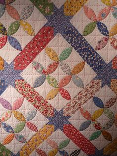 "love the primary vintage colors and large colored stitches  The perfect quilt for ""Grandma's Feather Bed""!"