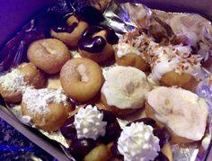 Cinnamon sugar, chocolate buttercream, cinnamon roll, powdered sugar, coconut cake, Boston Creme pie donuts