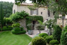 Country home near Uzes, France. I like the simplicity of this garden.