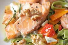 Spinach Fettuccine with sauteed salmon,  garlic and walnuts, blue cheese with cream cheese and roasted peppers.