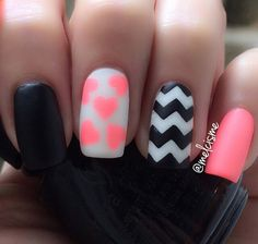 Really interesting looking winter nail art in black, white and pink polish. The variety of patterns makes the design look lively and interesting.
