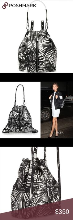 Elizabeth and James Cynnie Palm Print Bag Backpack Elizabeth and James- Cynnie Palm Printed Drawstring Backpack, White/Black. Brand new no dustbag. Retails $598. Gorgeous bag! Amazing that it can be worn 2 days- as purse or as a backpack. Love this bag for this reason. Elizabeth and James Bags