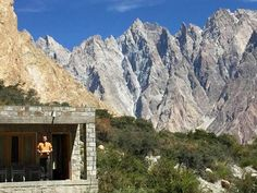 Pakistan - Holding the breakfast tray with the mighty Passu cones in the background. Picture: Viviana Mazza.