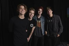 """When some of their most dedicated fans camped out overnight at The Forum in Los Angeles in July 2014 just to buy tickets for their upcoming concert, 5 Seconds of Summer attempted to make it worth their while. The group showed up at the venue that morning to sell the tickets to fans in person. Fans didn't just get to interact with the band members; they were treated to a live performance of the Australian band's hit songs """"She Looks So Perfect"""" and """"Amnesia."""""""
