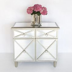 2 drawer, 2 door mirrored chest in plain mirror with painted silver wooden edging.