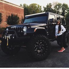Girl standing next to Large black jeep woth large wheels. Girl standing next to - -Large black jeep woth large wheels. Girl standing next to - - Auto Jeep, Maserati, Bugatti, Ford Gt, Ford Mustang Shelby, Mustang Cars, Dream Cars, My Dream Car, Pontiac Firebird