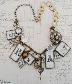 Charms and vintage button style necklace