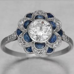 ".71 H SI1 OEC with medium blue sapphires ""French square-cut"" .56ctw and .12ctw diamonds in setting"