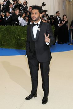 Met Gala 2017 Celebrity Red Carpet Outfits: The 2017 Met Gala red carpet is officially happening, and we would never dream of letting you miss a single standout look. We'll be here all night gathering the most out-there and most beautiful looks of the night. --- The Weekend, MetGala 2017, in a black suit. | Coveteur.com