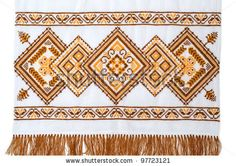 embroidered good by cross-stitch pattern. ukrainian ethnic ornament by mycola, via ShutterStock