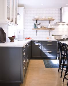 In this kitchen, senior design editor Sally Armstrong recommends painting ceilings, walls and upper cabinets in the same creamy white hue if you've chosen a dark lower cabinet color. She suggests Farrow & Ball's Wimborne White (239) for the ceilings, walls and uppers and Railings (31) for lowers.