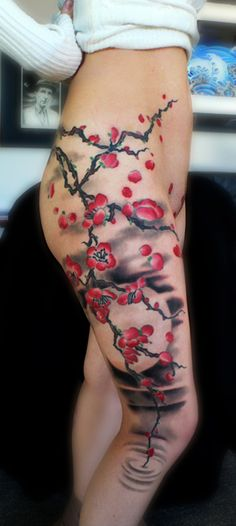 Kore Flatmo cherry blossom tree branch tattoo