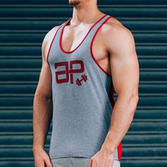 FormFit TT Vest - Grey & RedSHIPPING: PROCESSING TIME 3 - 4 Days ESTIMATED DELIVERY TIME 3 - 4 days for Domestic 4 - 6 days for International Superior quality cotton vest, simple design, tapered fit to showcase your physique. Designed with quality in mind, the same great feel after multiple washes, good as new for years to come. Styled for all day wear: complete with red printed logos & contrast stitching. #Musclesnotincluded 95% cotton, 5% Elastane Model is 5'11'' and wears an M Vest Click…