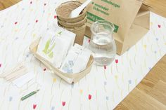 our spring shelf - a bag with soil, small spade or scooping spoon, seeds, pitcher with water, seedling pots, wooden sticks or little flags to write the names of plants