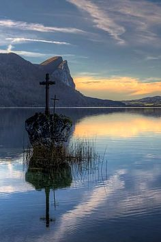 Cross on a rock, Mondsee lake, Salzkammergut, Austria   by Hartl Johann